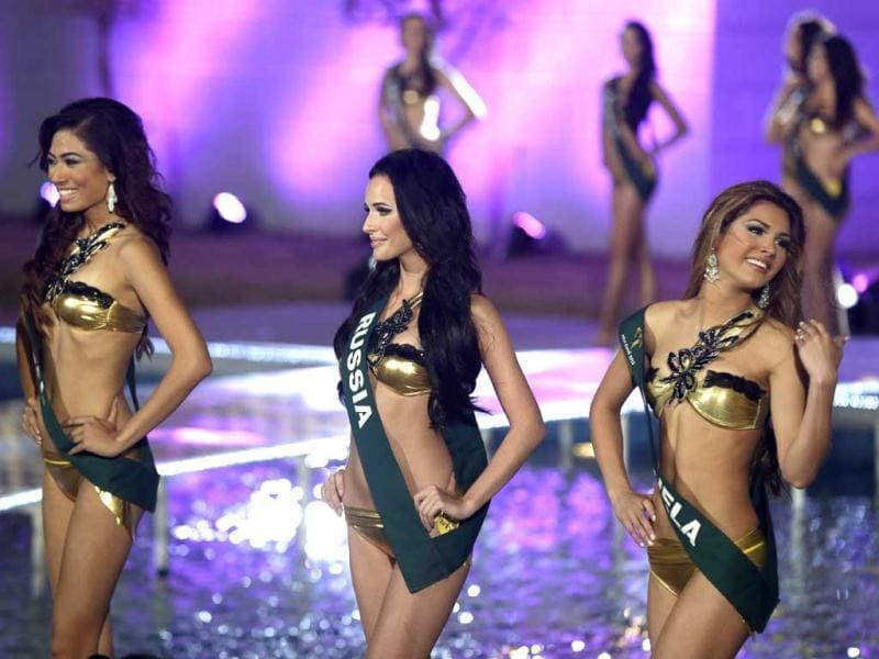 Miss Earth 2012 contestants, from left, Nagma Shrestha of Nepal, Natalia Pereverzeva of Russia, Osmariel Villalobos of Venezuela, pose shortly after being chosen in the Top Eight at the coronation night in Muntinlupa city, south of Manila, Philippines. AP Photo