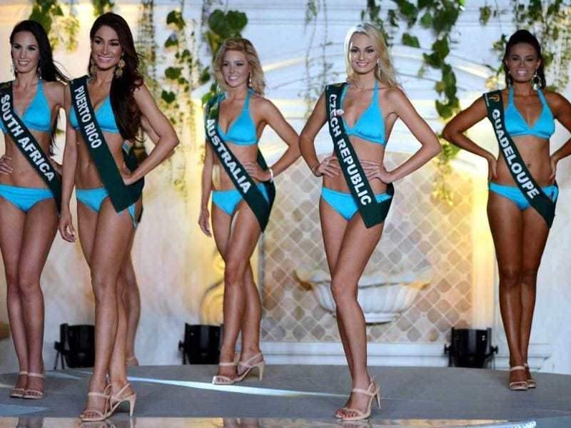 Contestants wearing swimsuits pose during the 2012 Miss Earth competition in Manila. Around 91 contestants from around the globe participated in the pageant with a theme in line with that of United Nations' celebration of the International Year of Sustainable Energy for all. AFP photo