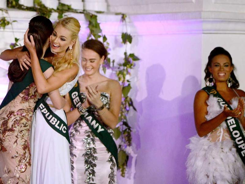2012 Miss Earth winner Tereza Fajksova of Czech Republic (2nd L) hugs 2012 Miss Air Stephany Stefanowitz (L) of the Philippines after she won the 2012 Miss Earth Competition in Manila. AFP photo