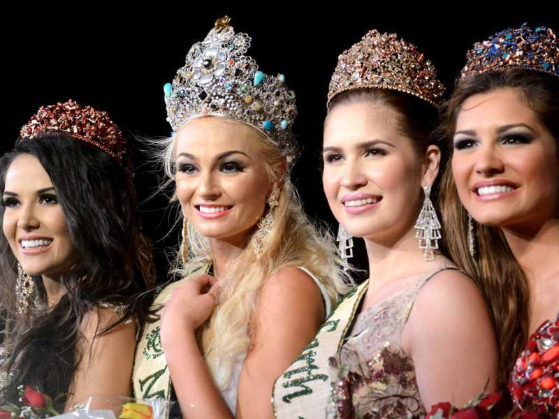 2012 Miss Earth winner Tereza Fajksova of Czech Republic (2nd L) poses with others winners Miss Fire Camila Brant (L) of Brazil, Miss Air Stephany Stefanowitz (2nd R) from Philippines, and Miss Water Osmariel Villalobos (R) from Venezuela during the coronation ceremony of the 2012 Miss Earth Competition in Manila. AFP photo