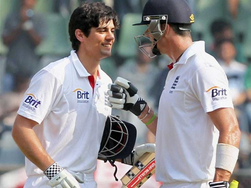 England's Kevin Pietersen congratulates Alastair Cook on his second consecutive century during the 3rd day of the second India-England cricket test match at Wankhade Stadium in Mumbai on Sunday. PTI photo
