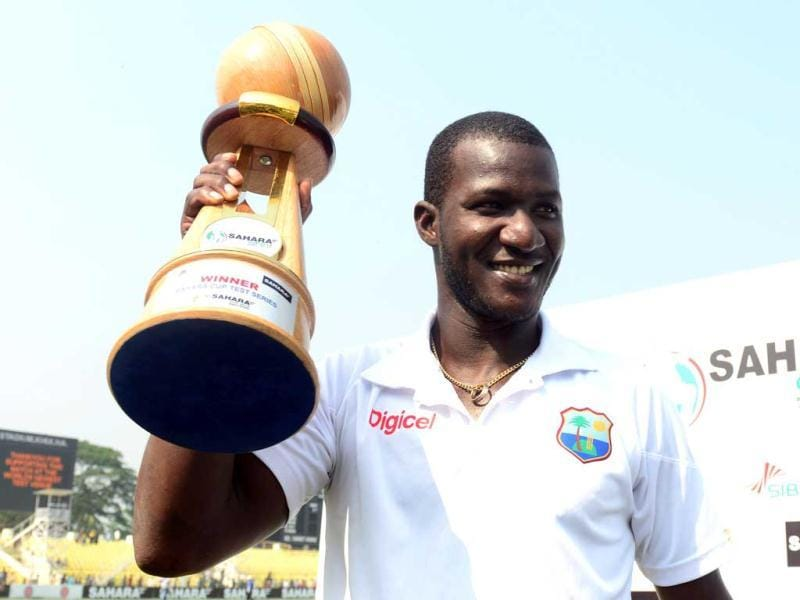 West Indies captain Darren Sammy holds the tournament trophy during the fifth day of the second Test match between Bangladesh and the West Indies at the Sheikh Abu Naser Stadium in Khulna. AFP