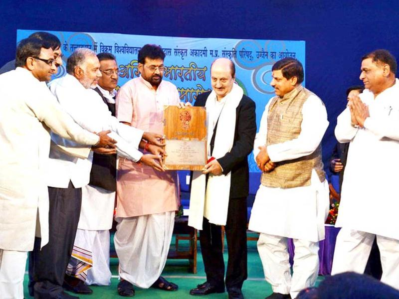 Madhya Pradesh culture minister Laxmikant Sharma conferred prestigious Kalidas Samman of the state government to famous theatre person and actor Anupam Kher at Ujjain. UNI Photo