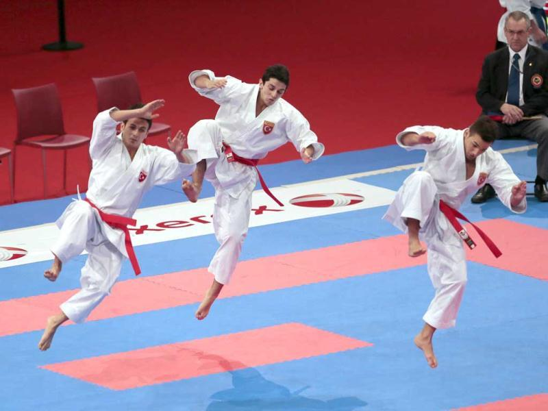 Turkish team members practice before the men's team Kata semi-finals against France in the Karate world championships at the POPB stadium in Paris. AFP Photo