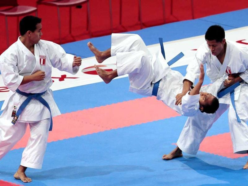 Peruvian team members compete against Egypt during the men's team Kata semi-finals of the Karate world championships at the POPB stadium in Paris. AFP Photo