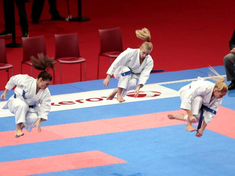 French team members (from L) Sonia Fuza, Clothilde Boulanger and Jessica Hugues compete and win a bronze medal in the semi finals of the female team Kata, during the Karate world championships at the POPB stadium in Paris. AFP Photo