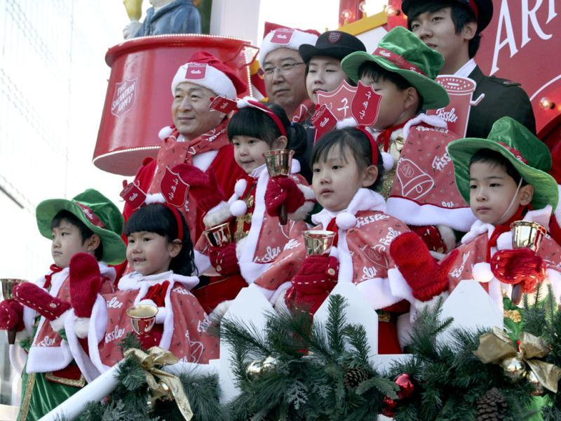 South Korean children wearing Santa Claus outfits attend a ceremony by the Salvation Army to prepare charity pots for a year-end fundraising campaign for the underprivileged in Seoul. AP Photo