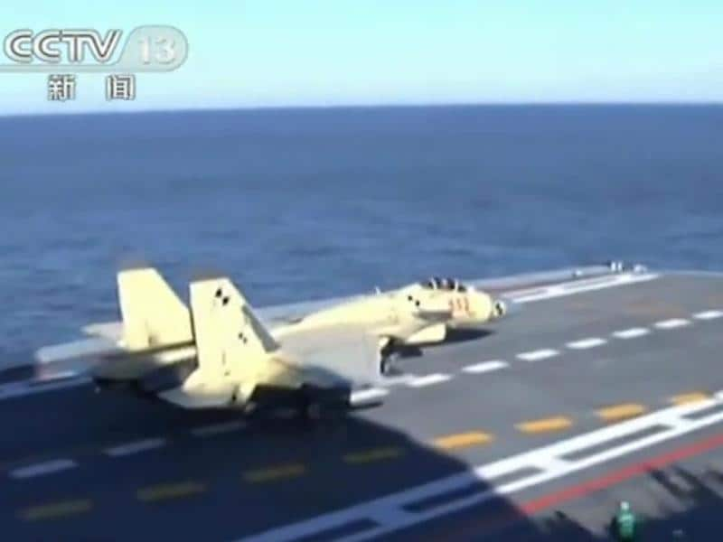 A Chinese-made J-15 fighter jet landing on the deck of the Liaoning, a former Soviet carrier, off the coast of China. AFP Photo/CCTV