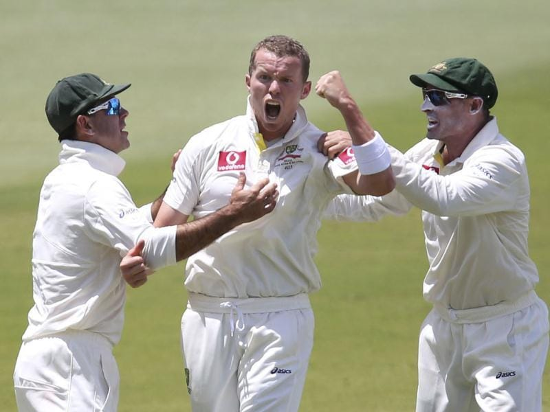 Australia's Ricky Ponting (L) and Mike Hussey (L) congratulate Peter Siddle (C) after he bowled out South Africa's AB de Villiers during the fifth day's play of their second cricket test match at the Adelaide cricket ground. Reuters Photo