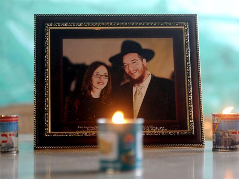 Traditional Jewish memorial candles are seen placed in front of a photograph of slain Rabbi Gavriel Holtzberg and his wife Rivkah, at the Chabad (Nariman) house in Mumbai. The Holtzbergs were killed in the attacks on Mumbai while the couple's son Moshe was rescued by their nanny. AFP/Indranil Mukherjee