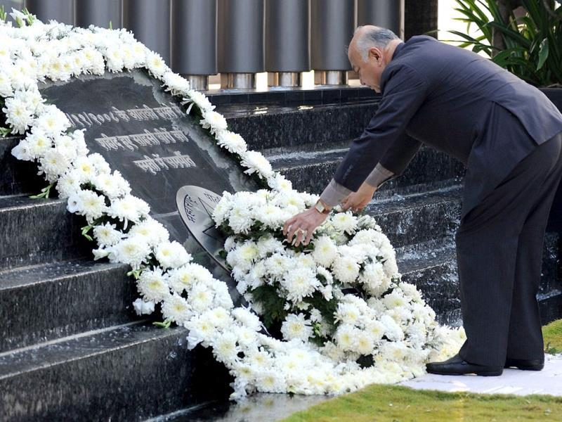 Home minister Sushil Kumar Shinde lays a wreath at a memorial for police and uniformed personnel who lost their lives in the 2008 terror attacks in Mumbai. AFP/Indranil Mukherjee