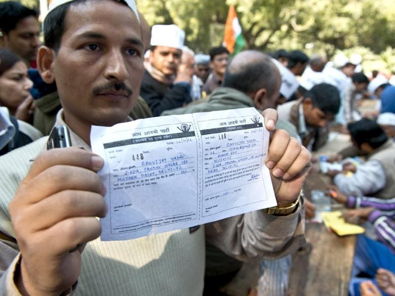 A supporter of activist turned politician Arvind Kejriwal displays the receipt of membership form during the launch of the Aam Aadmi Party in New Delhi. AFP Photo