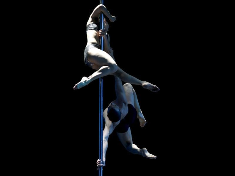 Argentine pole dancers Belen Serra and Joaquin Dazzotti compete to win first place in the Pole Dance South America 2012 competition in Buenos Aires. (AFP Photo)