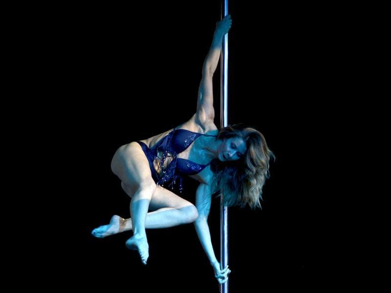 Pole dancer Lolo Hilsum of France, a member of the jury of the Miss Pole Dance Argentina and South America 2012 competition, performs before the awards ceremony in Buenos Aires. (AFP Photo)
