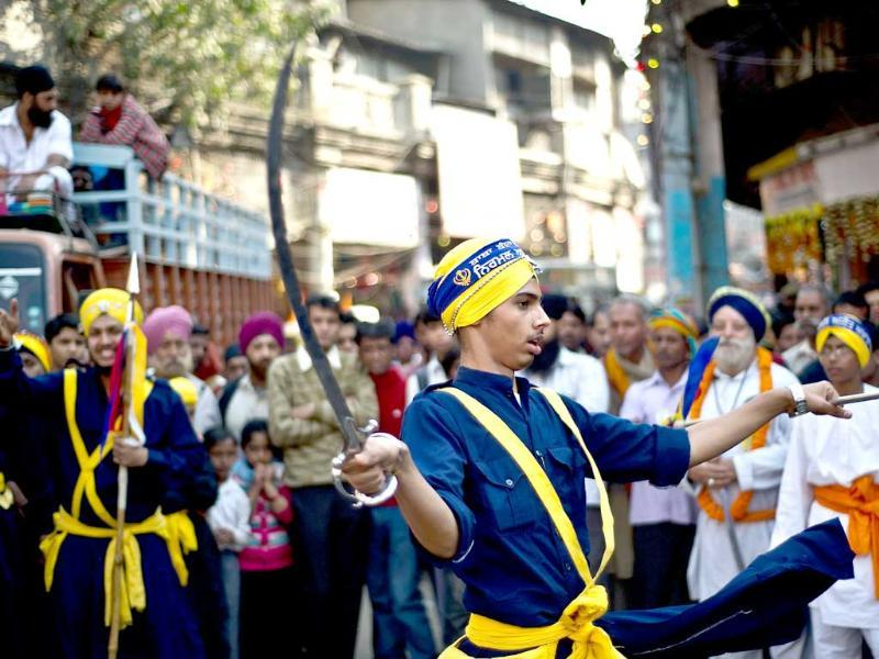 Sikh Nihangs - warriors - demonstrate their 'gatka' skills during a religious procession in New Delhi on the eve of the 543rd birth anniversary of Sri Guru Nanak. AFP Photo/Manan Vatsyayana
