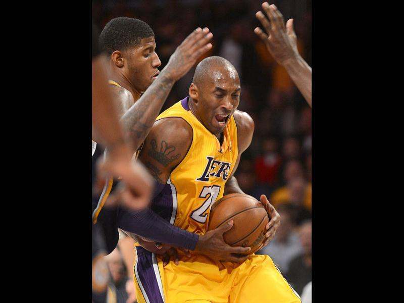 A Lakers Kobe Bryant drives to the basket during the game between the Los Angeles Lakers and the Indiana Pacers at the Staples Center in Los Angeles, California. AFP Photo