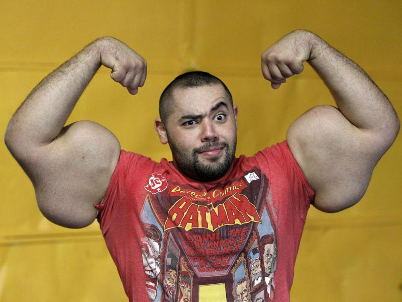 Stephan Savoia Moustafa Ismail, Egyptian Body builder Moustafa Ismail, poses during his daily workout at World Gym in Milford, Mass. Ismail has been given the title of world's biggest arms, biceps and triceps, by the Guinness Book of World Records. AP Photo