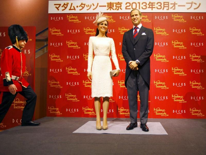 British guards of honor walk up on a stage after an unveiling ceremony of wax figures of Britain's Prince William and his wife Kate, the Duchess of Cambridge in Tokyo. Madame Tussauds announced on Wednesday that its wax museum will be open in Tokyo. AP Photo