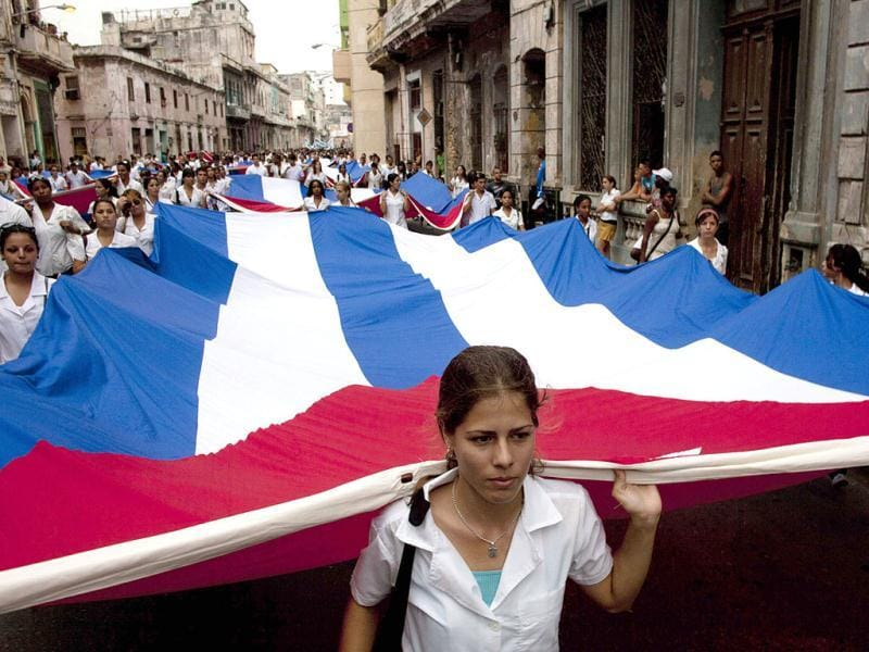 Students carry Cuba's national flag during a march marking the 141th anniversary of the execution of eight Cuban medical students by the Spanish colonial government during Cuba's Ten Years' War in Havana, Cuba. AP Photo