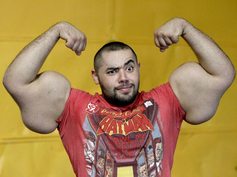 Egyptian body builder, Moustafa Ismail, poses during his daily workout at World Gym in Milford, Mass. Ismail has been given the title of world's biggest arms, biceps and triceps, by the Guinness Book of World Records. AP Photo