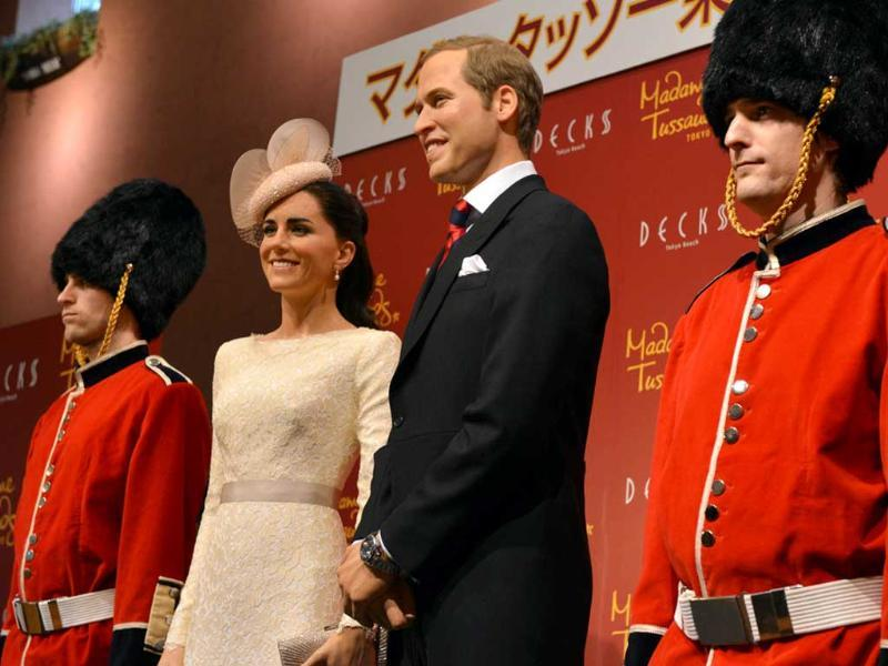 Wax figures of Britain's Catherine, Duchess of Cambridge and Prince William are displayed at a press preview in Tokyo. AFP Photo/Yoshikazu Tsuno