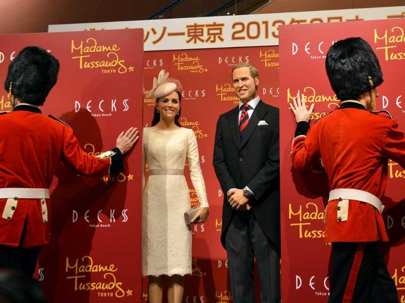 Wax figures of Britain's Catherine, Duchess of Cambridge and Prince William are unveiled at a press preview in Tokyo. AFP Photo/Yoshikazu Tsuno