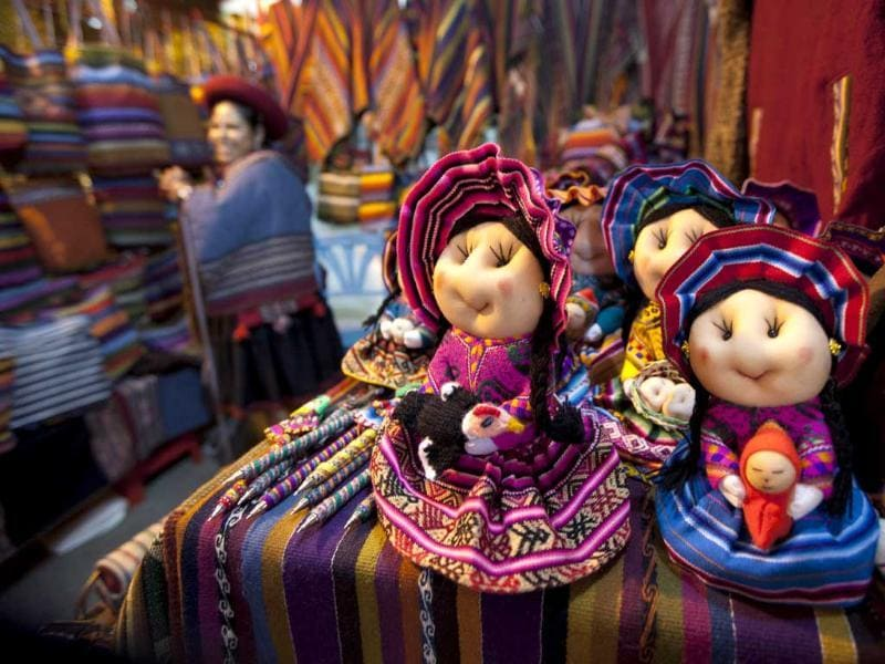 Martin MejiaDolls sit in a shop during an Andean fashion show featuring hand woven clothing in Lima, Peru. AP