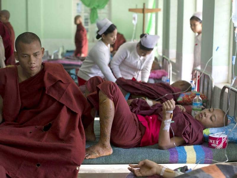 Buddhist monks with burn injuries are treated at a hospital in Monywa, northwestern Myanmar. Security forces cracked down on protesters occupying a copper mine, using water cannons and other devices to break up the rally hours before opposition leader Aung San Suu Kyi was expected to hear their grievances. AP