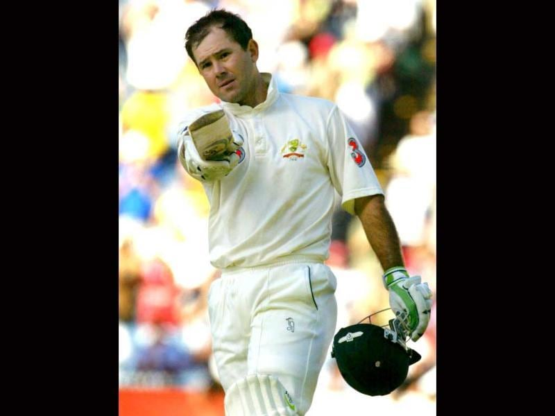 Ricky Ponting replaced Steve Waugh as Australia's 42nd test captain in 2004 before handing the reigns to Michael Clarke in 2011. In this file photo, Ponting acknowledges the applause after scoring his century on the second day of the third Test Match being played at the MCG in Melbourne 27 December 2003. (AFP Photo)