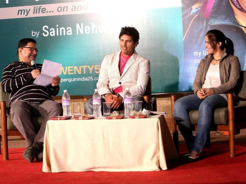 Yuvraj and Saina share a joke during the discussion of Saina's book launch in Delhi on Wednesday.