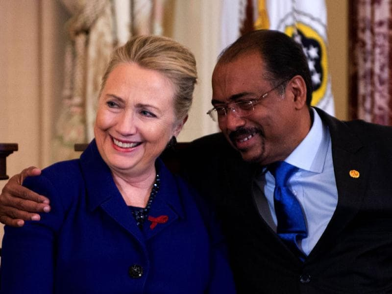 US secretary of state Hillary Clinton (L) is hugged by United Nations Aids Executive Director Michel Sidibe during an event in recognition of World AIDS Day at the State Department in Washington, DC. AFP/Jim Watson
