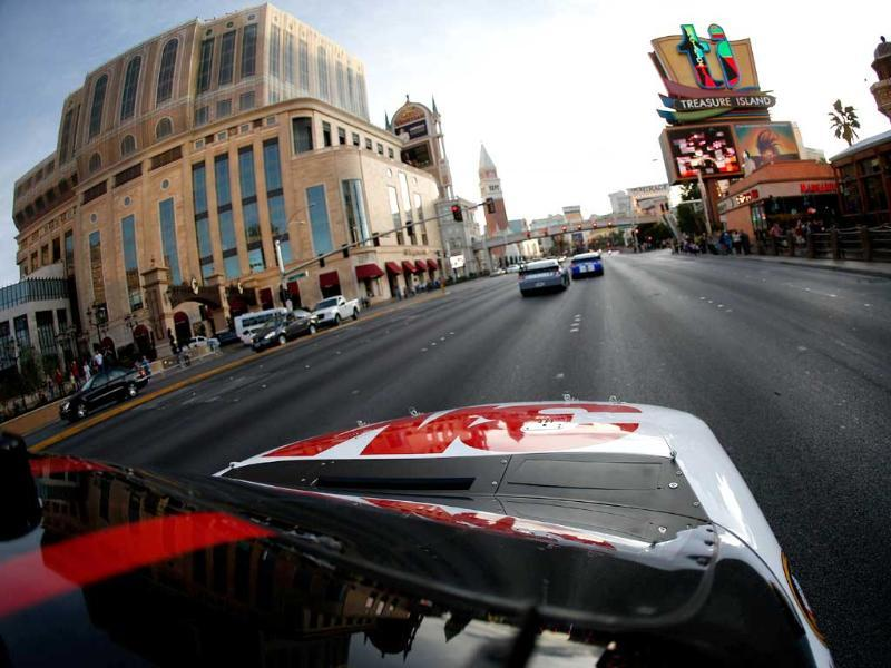 Greg Biffle, driver of the #16 3M Ford, drives on the street during the NASCAR Victory Lap on the Las Vegas Strip in Las Vegas, Nevada. AFP