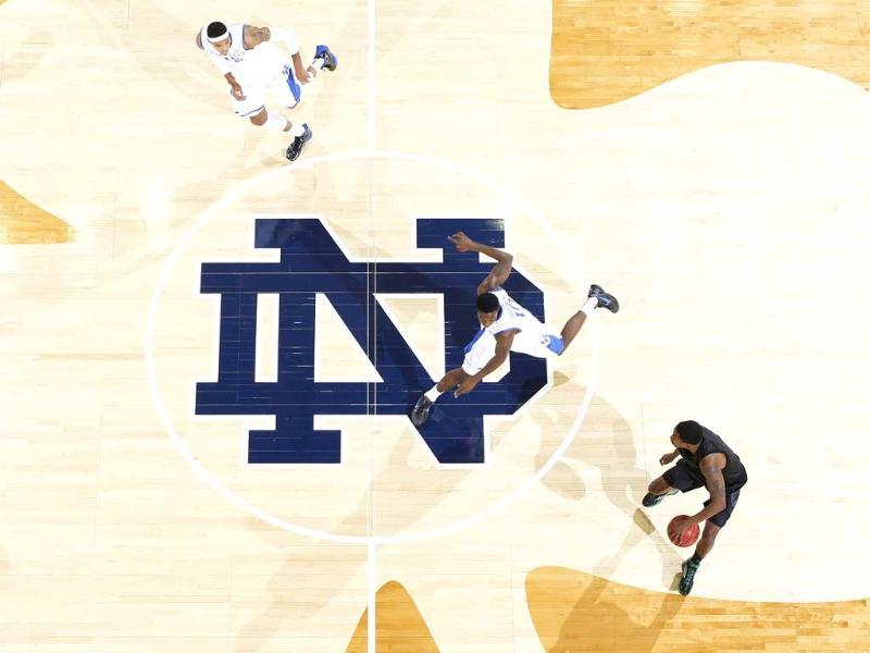 Eric Atkins of the Notre Dame Fighting Irish brings the ball up court against Archie Goodwin of the Kentucky Wildcats during the game at Purcell Pavilion at the Joyce Center in South Bend, Indiana. AFP