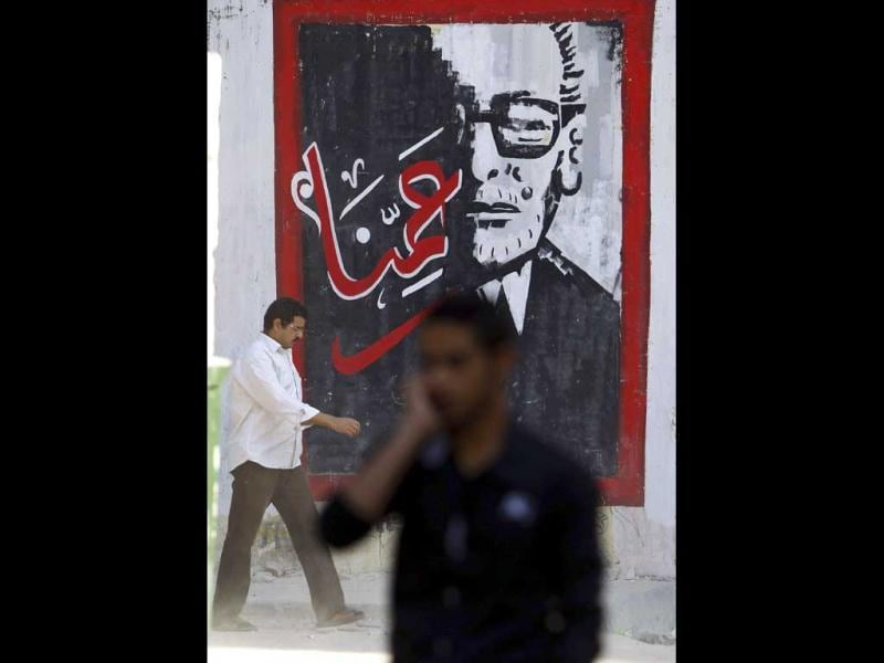 People walk past a mural of Egyptian novelist Naguib Mahfouz, who won the 1988 Nobel Prize for literature, at Mohamed Mahmoud street in Cairo. Reuters/Amr Abdallah Dalsh