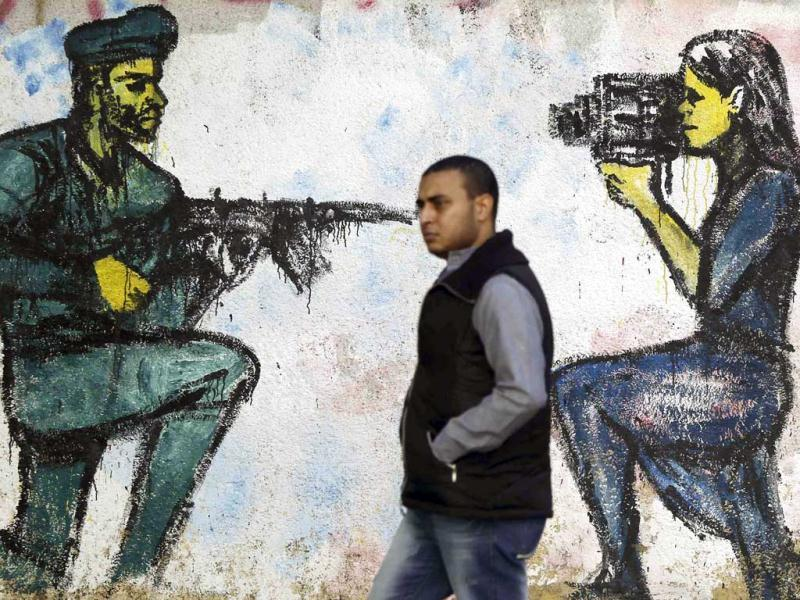 A man walks past murals at Mohamed Mahmoud street in Cairo. Reuters/Amr Abdallah Dalsh