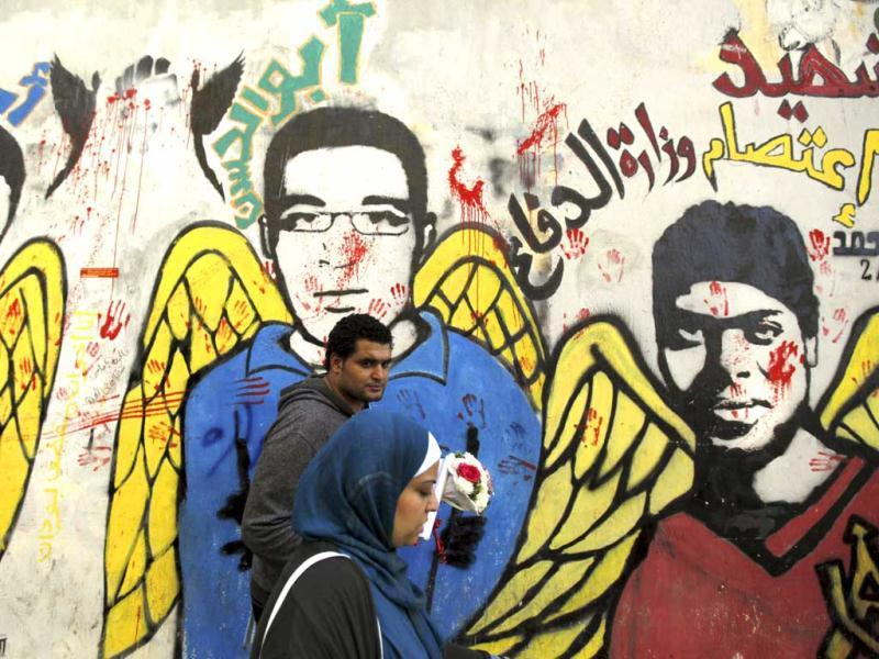 People walk past murals at Mohamed Mahmoud street in Cairo. Reuters/Amr Abdallah Dalsh