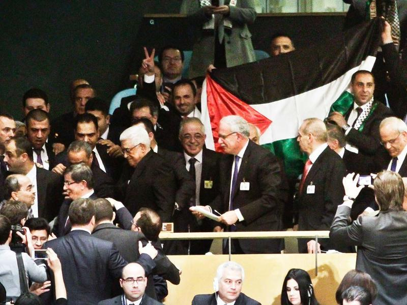 A Palestinian flag is displayed as Palestinian President Mahmoud Abbas leads his delegation from the UN General Assembly after a vote recognizing Palestine as a state in New York. AP