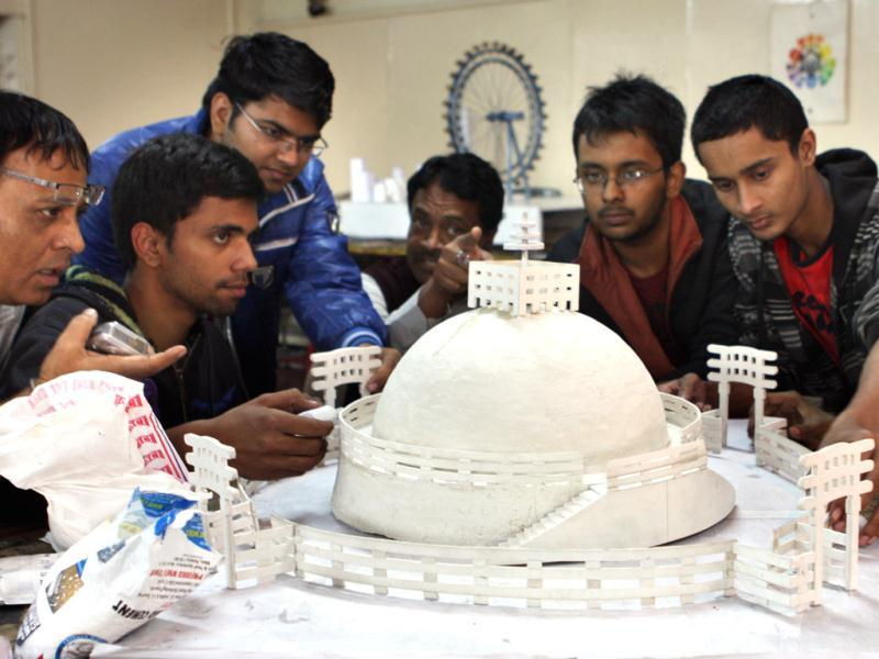 Students and techers of School of Planning and Architecture in New Delhi making the miniature replicas of famous monuments so that visually inpaired people can also experience them. HT/Sushil Kumar