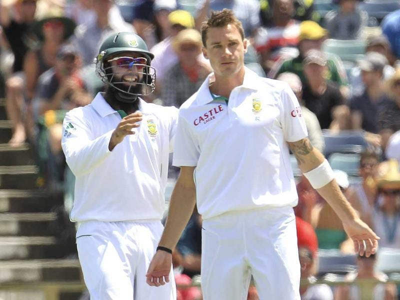 South Africa's Hashim Amla congratulates team mate Dale Steyn after dismissing Australia's Nathan Lyon at the WACA during the first day's play of the third cricket test match in Perth. Reuters
