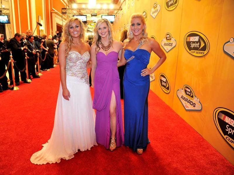 Miss Sprint Kristen Beat, Kim Coon and Jaclyn Roney arrive on the red carpet for the Nascar Sprint Cup Series Champion's Awards at the Wynn Las Vegas in Las Vegas, Nevada. AFP