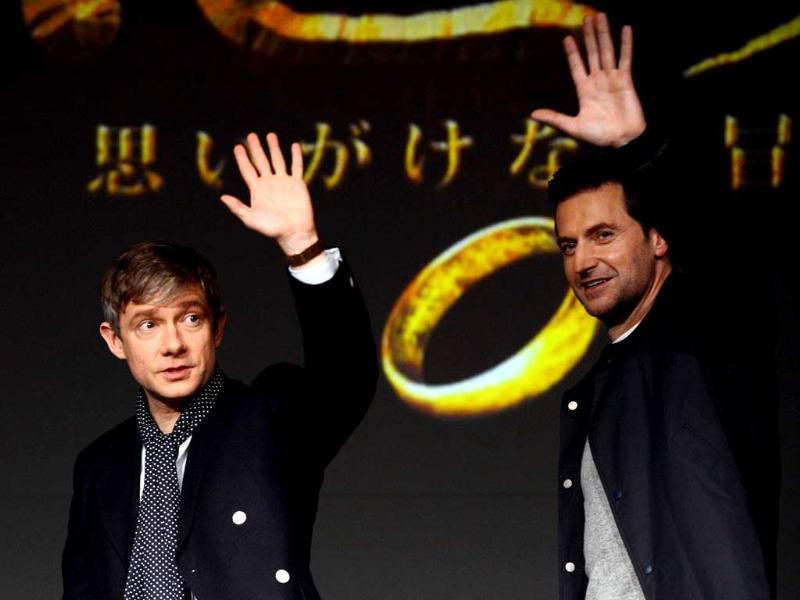 British actors Martin Freeman and Richard Armitage wave after a photo session of their latest movie -- The Hobbit: An Unexpected Journey in Tokyo. AFP