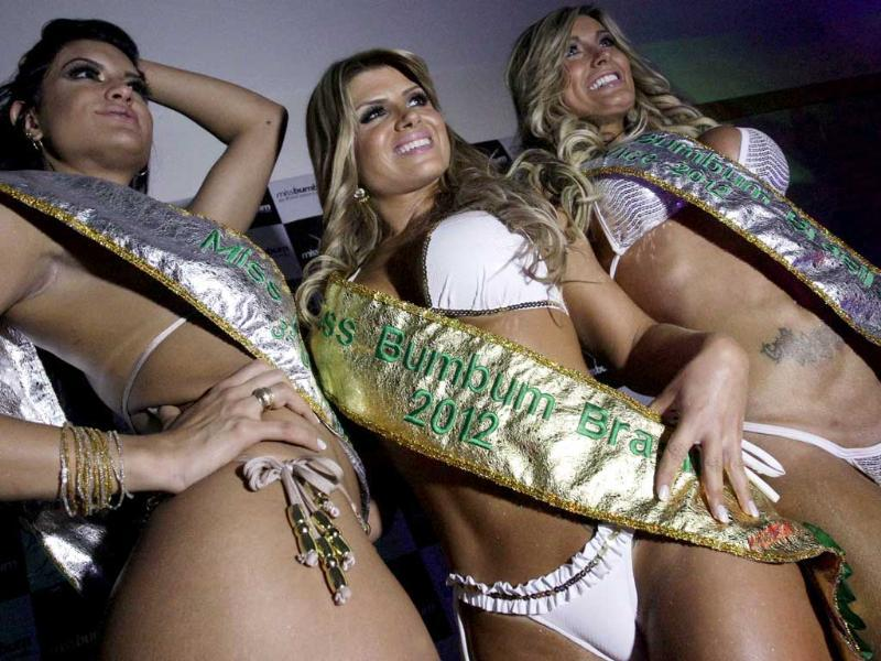 Winner Carine Felizardo, center, 3rd place winner Camila Vernaglia, left, and 2nd place winner Andressa Urach pose for photos at the Miss Bumbum Brazil contest in Sao Paulo, Brazil. AP