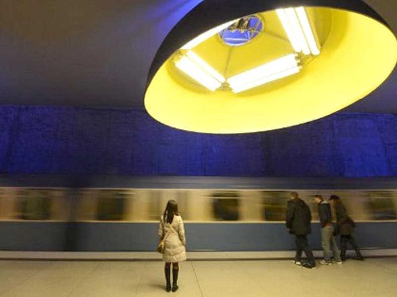 A train arrives in Westfriedhof subway station in Munich, southern Germany. It was opened in 1998. 11 large lamps bathe the station in blue, red and yellow light. AFP