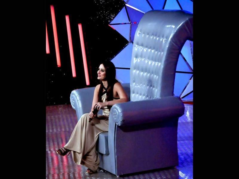 Kareena sits on the 'bigg' chair meant for guests on the show.