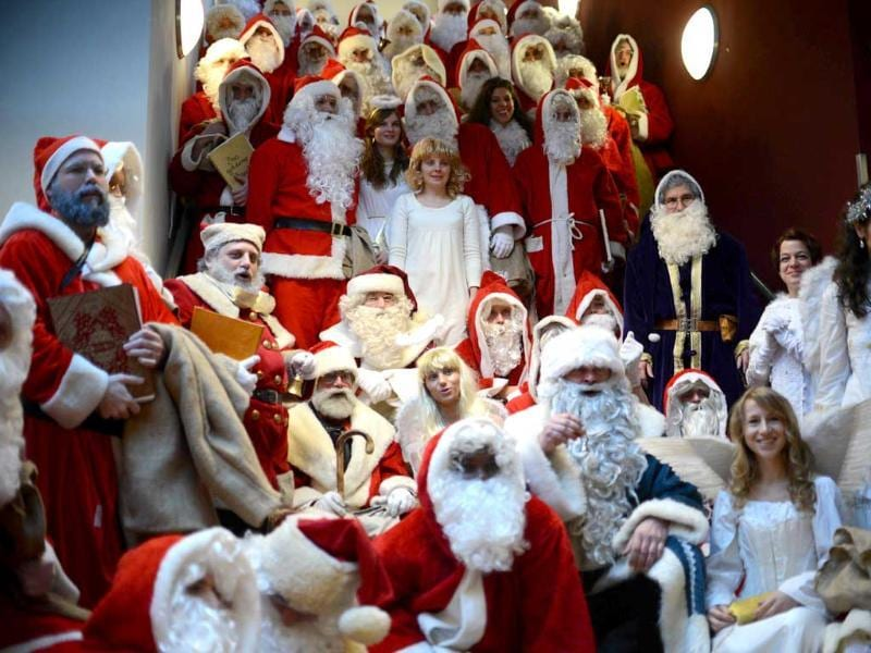 Women dressed as angels and men dressed as Santa Claus attend the annual meeting of volunteer Santa Clauses and angels in Berlin. AFP/Johannes Eisele