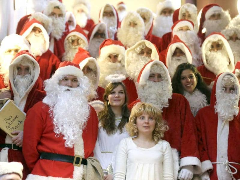 Volunteers dressed as Father Christmas and angels pose for a group picture during an annual Christmas meeting hosted by the student's association Studentenwerk in Berlin. Reuters/Tobias Schwarz