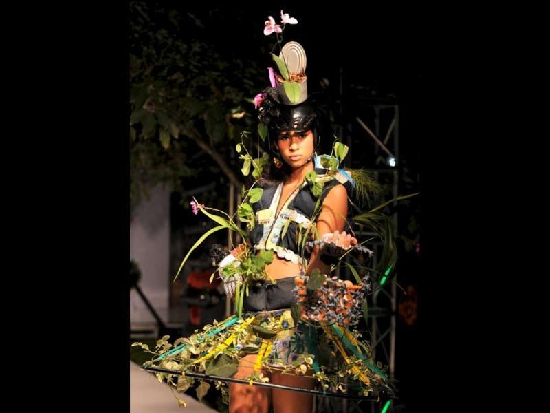 A model presents designs made with natural materials and live plants during the Bio Fashion Tropico Show in Colombia. (AFP/ Luis Robayo)