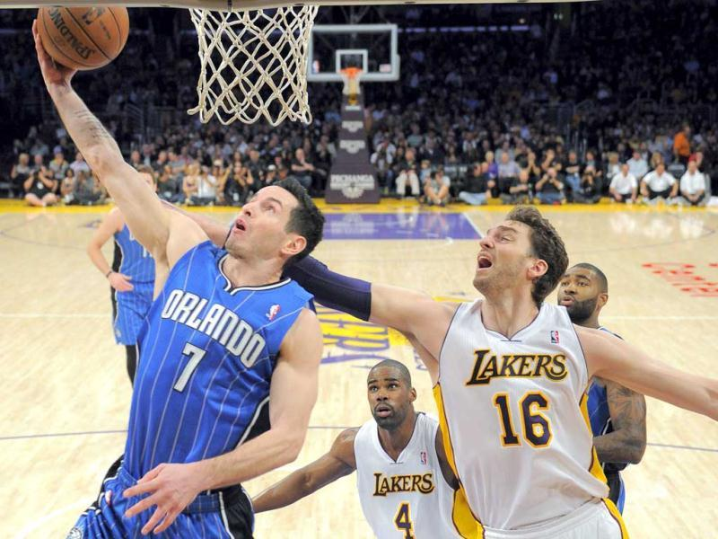 Orlando Magic guard JJ Redick puts up a shot as Los Angeles Lakers forward Pau Gasol defends during the first half of their NBA basketball game in Los Angeles. (AP Photo)