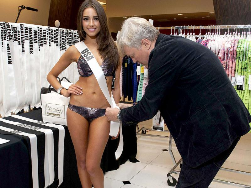 Miss Universe 2012 contestant Miss USA 2012, Olivia Culpo, is fitted by costume designer David Profeta upon arriving in Las Vegas, Nevada. (Reuters/ Handout)