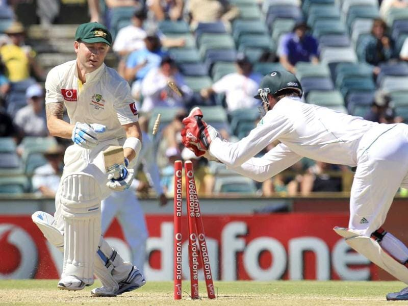 Australia's captain Michael Clarke is stumped by South Africa's AB de Villiers at the WACA during the fourth day's play of the third test cricket match in Perth. Reuters Photo